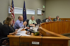 COURTNEY VAUGHN - Scappoose city councilors Barbara Hayden, Jason Meshell, Scott Burge, Joel Haugen and Rich Riffle discuss agenda items during a council meeting Monday, June 15. They approved a $15 million budget for 2015-16 that evening.