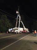 COURTESY OF COLUMBIA RIVER FIRE & RESCUE - Columbia River People's Utility District crews work on a power pole damaged after a truck crashed into it Tuesday night, June 30.