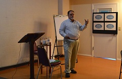 SPOTLIGHT PHOTO: MARK MILLER - Jim Tierney, executive director of the nonprofit Community Action Team Inc., leads off a 'Community Conversation on Poverty' in St. Helens on Tuesday, June 30.