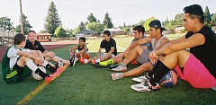 JOHN DENNY - Ryan Hardwick (second from left) talks with players during a recent Wednesday evening open field session at Gladstone. Pictured with Hardwick (left to right) are Austin Carlson, Aaron Hernandez, Andrew Contreras, Max Elmer, Ramon Garcia and Agustin Flores.