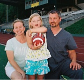 JOHN DENNY - This years Battle for the Bridge alumni football game will be a family affair for Sara and Ian Giammanco and their 8-year-old daughter Sophia. Ian will be playing linebacker for West Linns alumni team; Sophia is an honorary team captain; Sara will be their No. 1 fan. Sara and Ian both graduated from West Linn High School, Sara [maiden name Summers] in 1992 and Ian in 1994. Sophia has cystic fibrosis and she has been a poster child for the Battle for the Bridge alumni game since the first year the game was played, in 2011. This years game, between alumni of Oregon City and West Linn high schools is set for West Linn High School at 7 p.m. on Saturday, Aug. 8. All proceeds of the game will go to the Boomer Esiason Foundation and its efforts to fight cystic fibrosis.