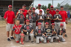 SUBMITTED - The Redland Wildcats proudly display their championship hardware from the recent Junior National county championship tournament. Pictured are: (front row, left to right) Jayce Dale, Josh Henkel, Noah Oistad, Robbie Regimbal, Gavin Fullington and Chase Salisbury; (second row) Autie Oistad, Cade Heitschmidt, Ryan Finseth, Cody Keith, Kelii Falapapalangi and Brandon OMalley; and (back) coach Ryan Dale, coach Jon Oistad, head coach Scott Salisbury, coach Neil Fullington and coach Rob Regimbal.