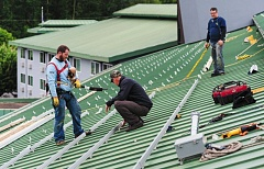 TRIBUNE FILE PHOTO - Here comes the sun: Roofers expect a boom in solar array installation in the next year in the run up to diminishing tax breaks.