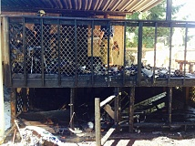 PHOTO COURTESY: CLACKAMAS FIRE - 14635 Quail Grove Circle's porch succumbs to a blaze on Saturday.