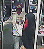 GLADSTONE POLICE DEPARTMENT - These two suspects are wanted for robbing an Arco service station in Gladstone.