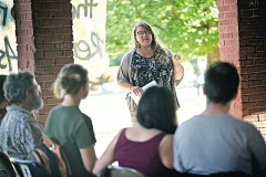 TRIBUNE PHOTO: JAIME VALDEZ - Kari Koch, a Portland activist,  tells citizens how she helped people fight foreclosures at the Renters Assembly at Colonel Summers Park in Southeast Portland.