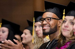 SUBMITTED PHOTO - Marylhurst University graduate Brandon Hoggans beams during his June 20 commencement ceremony.