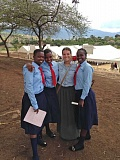SUBMITTED PHOTO - McKenzie Coulson is shown on a visit to Orkeeswa School in Tanzania in 2013. She first visited in 2008. The girl to the right is Eliapenda, the student being sponsored by Coulson.