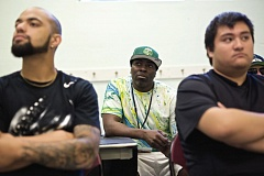 TRIBUNE PHOTO: JAIME VALDEZ - Community health worker Dwight Myrick (center) takes in the anti-violence message at a recent meeting for STRYVE (Striving to Reduce Youth Violence Everywhere) at Matt Dishman Community Center. Myrick is one of the first Multnomah County residents to undergo training in a program intended to help him teach at risk young adults how to resist turning to violence and gangs.