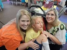 REVIEW PHOTO: CLIFF NEWELL - The Hall family of California had a lot of fun on Graduation Day at the Creative Arts Camp. From left: Jessica, camper Jordan and mom Sherri.