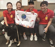 C.J. DRAKE - The visiting students from South Korea pose with Chelsea, a Project POOCH dog, at last week's visit to MacLaren Youth Correctional Facility. They are, (from left) Woo Jeong Kim, Yuree Ko, Hyuanjae Roo and Hyung Min Kim.