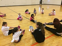 SUBMITTED PHOTO - Lauren Kuhns, captain of the Gladstone Gladettes dance team, leads Junior Gladettes at a dance clinic on Feb. 16.