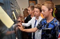 REVIEW PHOTO: VERN UYETAKE - Incoming Lakeridge Junior High sixth-graders Jacob Barton (right) and Nate Normile practice unlocking lockers as part of the Sixth Grade Success Skills class.
