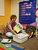 POST PHOTO: KYLIE WRAY - Lisa Sheppard organizes books in the preschool classroom at Impact Learning Center.
