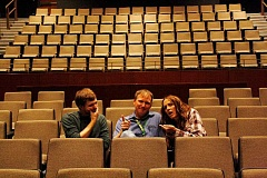 POST PHOTO: KYLIE WRAY - Alec Chase, Rob McGlothin and Tomi Griffin goof around in the Sandy High School auditorium, where the three of them will collaborate on the schools musical.
