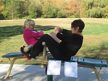 SUBMITTED PHOTO - Rita Donnelly, left, and Steve Campion use Fit Spot equipment to do sit-ups.