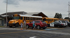 SPOTLIGHT PHOTO: NICOLE THILL - Buses line up outside of Warren Elementary School at dismissal time. The Scappoose School District has received complaints during the first two weeks of school about the new bus schedule.