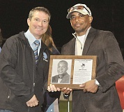GARY ALLEN - St. Paul Superintendent Joe Wuhrli (left) presents a Hall of Fame plaque to Jimi Winters, the son of the late James Winters, a former St. Paul educator who was Oregons first African American head basketball coach. Winters was one of four individuals inducted in the 2015 St. Paul Hall of Fame ceremony at halftime of Fridays football game between the Bucks and Creswell Bulldogs. Winters was joined by Karen Case, Bob Coleman, Dee McKillip and the 1959 state finalist football team among those inducted this year.