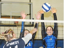 SETH GORDON - Block party - McGwire Smith and Sydney Brentano rise in an attempt to block a hit  during St. Paul's 3-0 sweep over rival Kennedy Sept. 15. The Bruins are 8-1 and ranked       No. 2 in the OSAA Class 2A rankings.