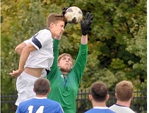 SETH GORDON - Heads-up play - Senior defender Josh Scarth attempts to head a cross before Trinity Lutheran goalie David Johnson can grab the ball during George Fox's 4-0 win over the Eagles Sept. 16 at the Austin Sports Complex.