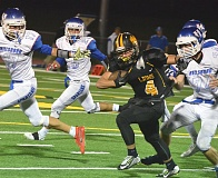 JOHN BREWINGTON - Myles Terry had to take over Friday as quarterback after Levi Norton was injured earlier in the week. Terry did a credible job, both as QB and a running back, but the Lions fell to Hilhi. Norton is expected back for the Putnam game in St. Helens on Friday.