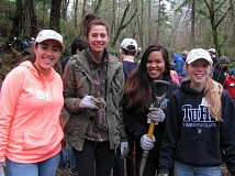 COURTESY OF THE CITY OF TUALATIN - Volunteers like these ones on Martin Luther King Jr. Day clean up invasive species and plant native trees and shrubs around the Tualatin area as part of the 'Put Down Roots in Tualatin' program.