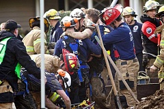 PAMPLIN MEDIA GROUP FILE PHOTO - In March 2014, first responders rescued Danny Russu, age 21, from a trench after he became trapped while performing maintenance on a sewer line in Beaverton.