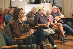 INDEPENDENT PHOTO: TYLER FRANCKE - Stefani Carlson, far left, and other area residents attended a meeting last week at The Place to Be Cafe in Canby to discuss a spate of cougar attacks in September.