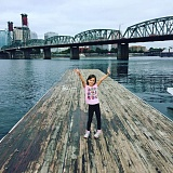 PHOTO BY KEVIN WAGONER, COURTESY HUMAN ACCESS PROJECT - Wren Zitzelberger enjoys the nice weather on the Holman Dock, just south of the Hawthorne Bridge, which the city eventually plans to take down.