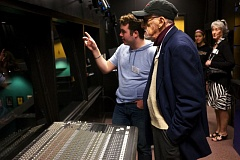 TIMES PHOTO: JAIME VALDEZ - Denis Eckert, a senior at Southridge High School, shows playwright George Herman the sound room in the theater at the school.