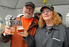 SPOKESMAN PHOTO: VERN UYETAKE - Dave and Cinda Hodson enjoy sampling brews at Saturday's Ale Festival.