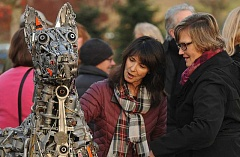 REVIEW PHOTOS: VERN UYETAKE - Dawn Grunwald and Kathy Kern get a close-up look at Guardian of the Lake after artist Brian Mocks sculpture was unveiled near Luscher Farm.