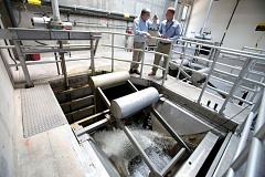 FILE PHOTO - Clackamas County officials talk in the Tri-City sewage treatment plant in Oregon City.