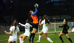 DAN BROOD - Tualatin senior goalkeeper Emily Leonard, shown here making a leaping grab of a corner kick in Saturday's state title match, shined the past two years in penalty-kick shootouts.