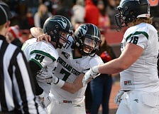 COURTESY: JESSE TINSLEY/THE SPOKESMAN-REVIEW - Portland State quarterback Alex Kuresa (center) celebrates with tight end Cam Sommer (left) and offensive lineman Mike Davis after Sommer's touchdown catch from Thomas Carter during a 34-31 PSU victory Saturday at Eastern Washington.