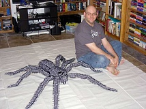 COURTESY PHOTO - Jason Ruff poses next to his LEGO spider, which will be on display as part of a new Washington County exhibit later this month.