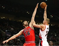 TRIBUNE PHOTO: DAVID BLAIR - Portland center Mason Plumlee (right) tries to hoist a shot over Chicago's Pau Gasol.