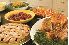 (Image is Clickable Link) TRIBUNE FILE PHOTO - Mmmmmm. Thanksgiving dinner is part of the fun at the fourth annual potluck hosted by redditors Mike Alfoni and Marie Young.