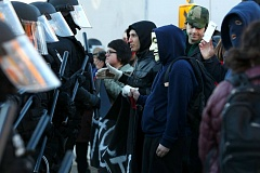TRIBUNE PHOTO: JONATHAN HOUSE - Don't Shoot PDX protesters confronted a row of Portland police during a Black Friday protest during a Nov. 27 march through Northeast Portland.