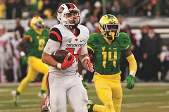 TRIBUNE PHOTO: JOSH KULLA - Oregon State running back Ryan Nall scampers for a 66-yard touchdown late in Friday's Civil War game, a 52-42 Oregon victory, its eighth straight in the annual rivalry series.
