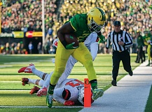 TRIBUNE PHOTO: JOSH KULLA - Bralon Addison scores one of his four touchdowns Friday in Oregon's 52-42 Civil War victory over rival Oregon State.