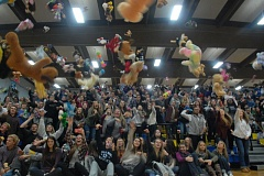 CONTRIBUTED PHOTO: BARLOW YEARBOOK STAFF - Stuffed animals rain down on the Barlow High gym floor during its annual toy toss.