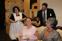 SUBMITTED PHOTOS - From left are Arleen Daugherty as Maria, Elisabeth Goebel as Florence Foster Jenkins, Mary Weigel as Dorothy and Todd Carlson as St. Clair, in New Century Players production of Glorious! The True Story of Florence Foster Jenkins, the Worst Singer in the World which opens Jan. 8 at Rex Putnam Blackbox Theater in Milwaukie.