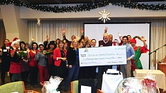 SUBMITTED PHOTOS - North Clackamas Chamber of Commerce members celebrate after raising $5,370 for the Historical Outreach Foundation at the annual Christmas Giving Breakfast.