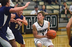 HERALD PHOTO: COREY BUCHANAN - Tigard's Luke Smith looks for room to shoot during his team's 69-59 win oer Canby at Tigard High School on Friday night.