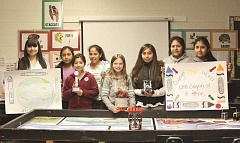 LINDSAY KEEFER - Woodburn Girl Scout Troop 14106 sent a team to the FIRST Lego League's regional and state competition. The team is composed of (from left) Ashley Guerra, Angie Lopez, Luz Rojas, Gladys Giron Solorio, Genevieve Trentzsch, Lili Reyes, Lesly Lopez and Jasmine Lopez.