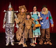 COURTESY PHOTO - (L-R) The Tin Man (Kassie Switzer), Cowardly Lion (Hallie Bartell), Toto (Carter Dawes), Dorothy (Mackenzie Gross) and Scarecrow (Caleb Kinder) liven up the Theatre in the Grove stage with a youth performance of the Wizard of Oz.
