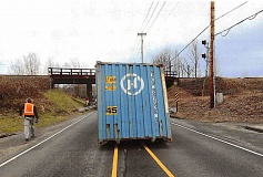CONTRIBUTED PHOTO: FAIRVIEW POLICE DEPARTMENT - This shipping container found a new home on Northeast 223rd Avenue for about 5 hours Monday, Jan. 18 when it was knocked off the back of a truck.