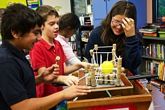 TIMES FILE PHOTO - Hassan Hashmat, left, Luke Young and Jo Carbajal, students at MITCH Charter School, react during a science workshop earlier this school year.