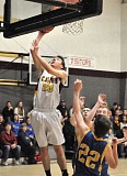 GARY ALLEN - Austin Friedrich skies for a layup during C.S. Lewis Academy's 67-36 home win over Jewell Friday night. Friedrich recorded a double-double with 10 points and 10 rebounds.